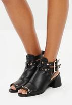 Truffle - Stud and buckle strap peep toe block heels - black