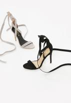 Truffle - Wraparound stiletto sandals - black