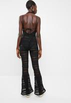 Missguided - Strappy crochet plunge flared jumpsuit - black