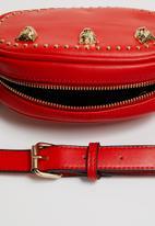 Superbalist - Lion studded waist bag - red