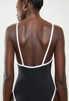 Lithe - Strappy one piece with contrast binding black & white