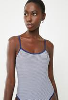 Lithe - Strappy one piece with contrast binding - navy & white