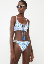 a2c5e796a606a Criss-cross front bikini set - blue and white Lithe Bikinis ...