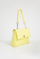 Anni King - Daffodil leather twist lock handbag - yellow