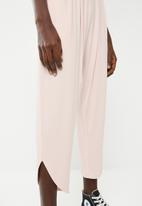 Superbalist - Strappy yoga jumpsuit with pockets at the hip - pink