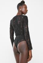 Missguided - Sport tape long sleeve bodysuit - black