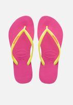 Havaianas - Slim logo pop-up flip flops - pink & yellow