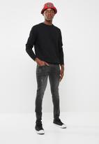 Superbalist - Skinny jeans with released hem - black