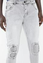 S.P.C.C. - Trench skinny denim with roping detail on the knee - grey