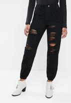 Missguided - Wrath mid rise distressed jogger jean - black