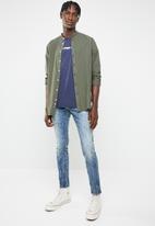 G-Star RAW - Revend skinny vintage aged destroy jeans - blue