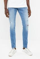 G-Star RAW - Revend skinny medium aged destroy jeans - blue