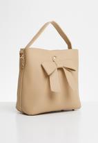 Joy Collectables - Bow detail bag - neutral