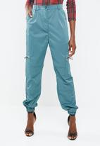 Missguided - Shell suit cargo trouser - green