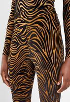 Missguided - Zebra velvet flare trousers - brown