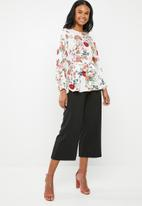 G Couture - Printed top with back buttons and waist tie - multi