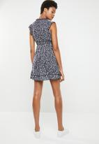Revenge - Empire line frill dress with front tie - navy