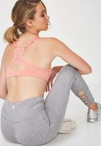 Cotton On - Medium impact contour sports bra - peach & grey