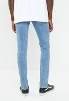 Cheap Monday - Tight fit knee rip jeans - blue