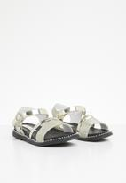 POP CANDY - Metallic crossover sandals - gold