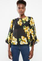 Revenge - Floral sheer top with volume sleeve - multi