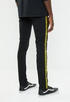Cheap Monday - Tight fit tape jeans - black