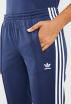 adidas Originals - Track pants side trefoil side stripes - blue