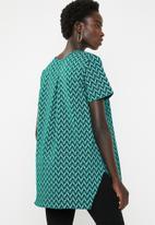 AMANDA LAIRD CHERRY - Sibongiseni geo retro top - teal