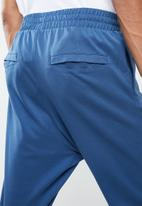 Reebok Classic - Track pants - blue