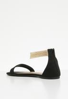 0645557dc794d Salvin faux suede metallic ankle strap flat sandal - black Call It ...