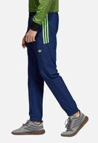 adidas Originals - Flames RK woven track pants - blue