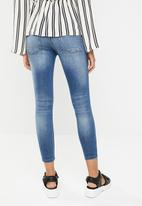 Jacqueline de Yong - Skinny low magic destroy ankle jeans - blue