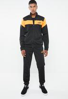 PUMA - Clean tricot tracksuit - black & yellow