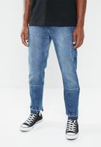 Superbalist - Cropped patchwork jeans - blue