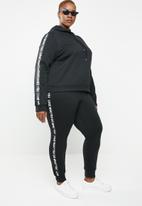 STYLE REPUBLIC PLUS - Slogan jogger - black & white