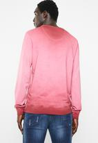 S.P.C.C. - Reverse dirty dye logo sweater - red