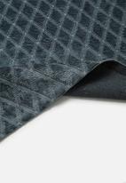 Sixth Floor - Viscose Moshi rug - blue & teal