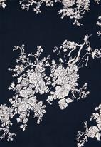 Revenge - Floral dip hem fluted sleeve top - navy