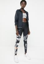 Under Armour - Balance printed leggings - black