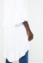 Revenge - Bell sleeve dip hem top - white