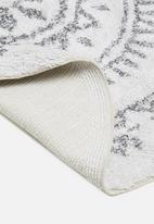 Sixth Floor - Sonja round tufted rug - white & black