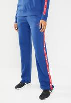 Nike - Track pants with tape detail - blue