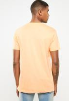 Cotton On - Nyc wolf T-shirt - peach