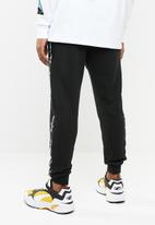 Cotton On - Trippy slim trackie - black