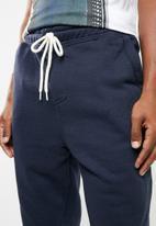 Cotton On - Trippy slim trackie - navy