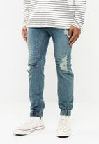 Cotton On - Blow out slim denim jogger - blue