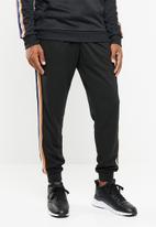 Cotton On - Slim ribbed tape tricot track jogger - black