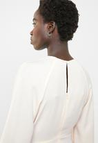Revenge - Tie front blouse with open back - pink