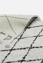 Sixth Floor - Diamond tufted rug - cream & black