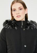 Revenge - Puffer coat with faux fur hood - black